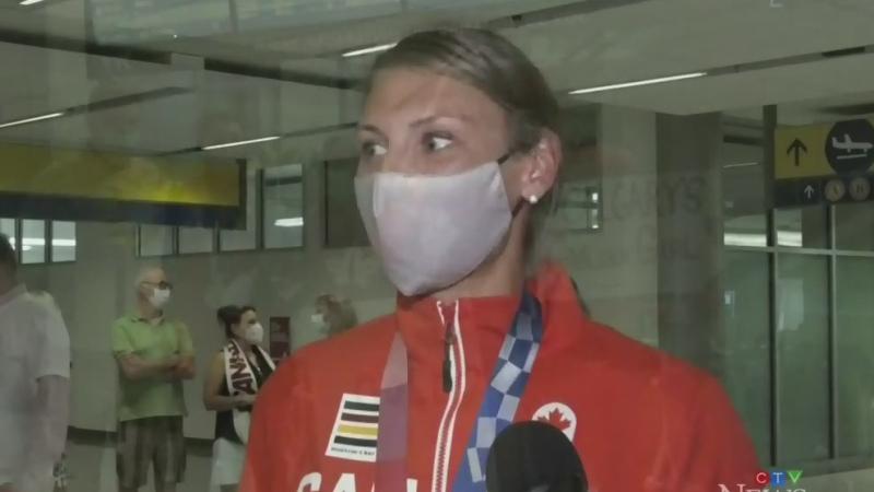 Newly-minted Olympian returns to Calgary