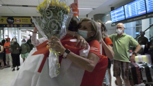 Kasia Gruchalla-Wesierski arriving in Calgary, greeted by family and friends.