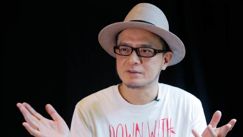 In this Saturday, June 1, 2019, photo, Hong Kong singer Anthony Wong speaks during an interview in Hong Kong. (AP Photo/Kin Cheung)