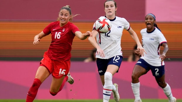 Canada's Janine Beckie, left, and United States' Tierna Davidson battle for the ball during a women's semifinal soccer match at the 2020 Summer Olympics, Aug. 2, 2021, in Kashima, Japan. (AP Photo/Fernando Vergara)