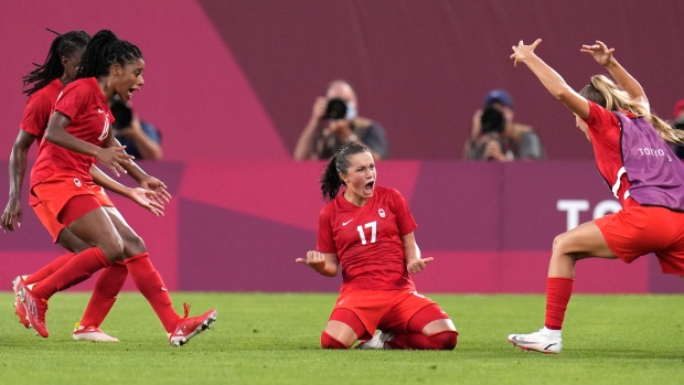 Canada's Jessie Fleming, 17, celebrates scoring the opening goal on a penalty kick during a women's semifinal soccer match against United States at the 2020 Summer Olympics, Aug. 2, 2021, in Kashima, Japan. (AP Photo/Fernando Vergara)
