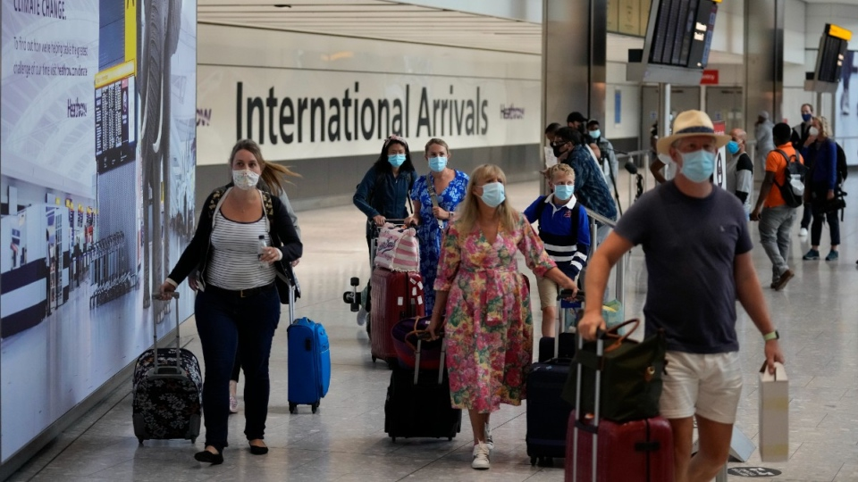 Travellers arrive at Heathrow Airport