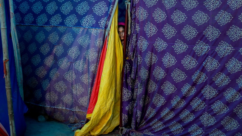 A Rohingya refugee woman at a refugee camp on the banks of the Yamuna River in New Delhi, on July 1, 2021.  (Altaf Qadri / AP)