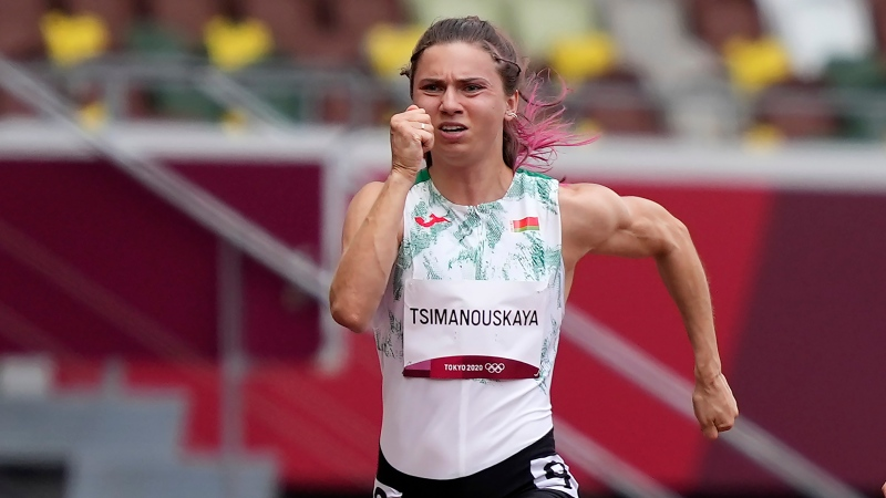 Krystsina Tsimanouskaya, of Belarus, runs in the women's 100-meter run at the 2020 Summer Olympics, Friday, July 30, 2021. (AP Photo/Martin Meissner)