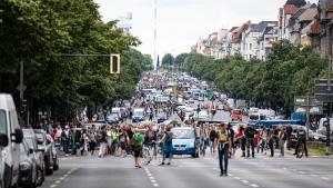 Demonstrators walk along Bismarckstrasse in Berlin, on Aug. 1, 2021. (Fabian Sommer / dpa via AP)