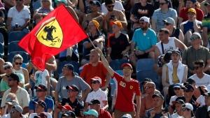 A fan waves a Ferrari flag during qualifying for the Hungarian Formula One Grand Prix, on July 31, 2021. (David W Cerny / Pool via AP)