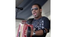 In this Sunday, May 4, 2008, file photo, Chris Ardoin, of Chris Ardoin & NuStep, performs during the 2008 New Orleans Jazz & Heritage Festival at the New Orleans Fairgrounds Racetrack in New Orleans. (AP Photo/Dave Martin, File)
