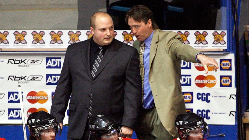 Quebec Remparts coach Patrick Roy, right, talks with assistant coach Martin Laperriere during first period Memorial Cup action in Moncton, N.B. on Sunday, May 21, 2006.(CP PHOTO/Andrew Vaughan)