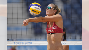 Beach volleyball player Sarah Pavan of Kitchener, Ont. competing on Day 10 of the Tokyo Olympic Games. (Courtesty: The Canadian Press)