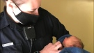 Edmonton Police Const. Sherwood pays a visit to a newly-adopted baby she had found abandoned in April (@AFPAElliott / Twitter)