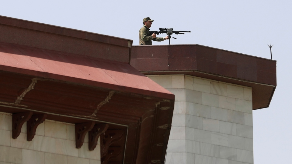 Rooftop security stands guard