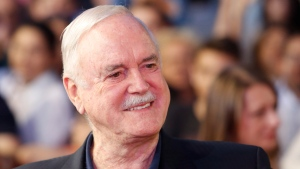 English actor John Cleese poses for photo as he walks on the red carpet to receive Sarajevo Film Festival's top honour award, the Heart of Sarajevo Award, in Sarajevo, Bosnia, on Wednesday, Aug. 16, 2017. (AP Photo/Amel Emric)