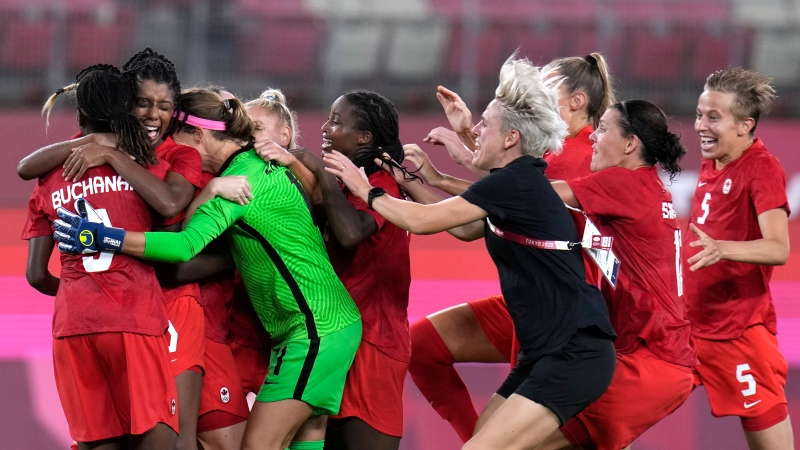 Canada's players celebrate after winning 1-0 to United States during a women's semifinal soccer match at the 2020 Summer Olympics, Monday, Aug. 2, 2021, in Kashima, Japan. (AP Photo/Fernando Vergara)