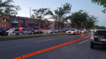Police tape blocks traffic at the scene of a shooting in Montreal's Riviere-des-Praries borough on Monday, Aug. 2, 2021. (Image courtesy of Antoinette Delli Compagni)