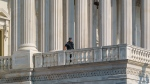 A U.S. Capitol Police officer keeps watch at the House of Representatives early Wednesday, July 28, 2021, at the Capitol in Washington. (AP Photo/J. Scott Applewhite)