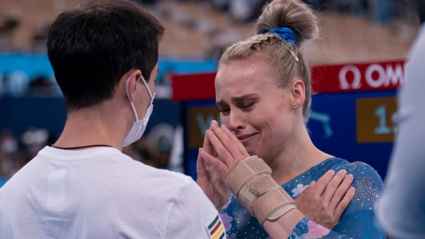 Canadian gymnast Ellie Black speaks with her coach David Kikuchi after competing in the balance beam final at the 2020 Tokyo Olympics, August 3, 2021 in Japan. THE CANADIAN PRESS/Adrian Wyld
