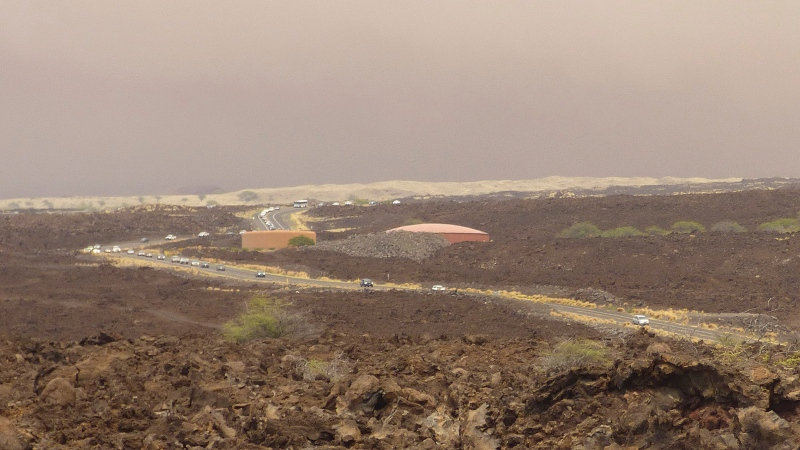 Vehicles are backed up on Waikoloa Road after a mandatory evacuation was ordered as a wildfire approached the Waikoloa Village area of Hawaii, Sunday, Aug. 1, 2021. A second emergency route was later opened to provide residents another way out. (Chelsea Jensen/West Hawaii Today via AP)