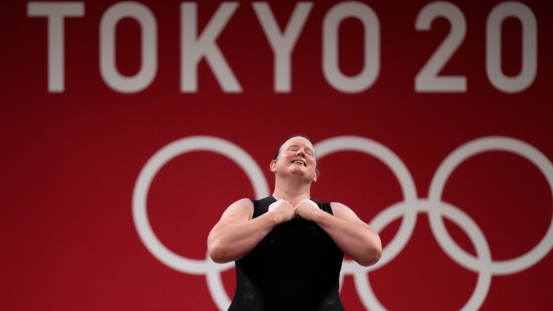 Laurel Hubbard of New Zealand says bows after a lift, in the women's +87kg weightlifting event at the 2020 Summer Olympics, Aug. 2, 2021, in Tokyo, Japan. (AP Photo/Luca Bruno)