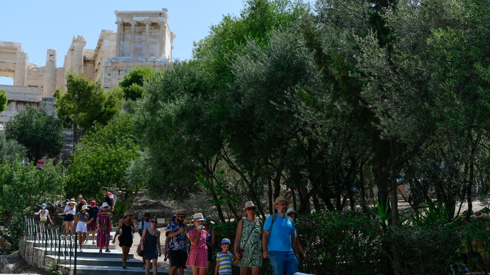 Tourists exit the ancient Acropolis in Athens