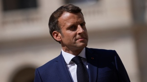French President Emmanuel Macron attends a farewell ceremony for the French armed forces chief of staff, Gen. Francois Lecointre at the Invalides monument in Paris, Wednesday, July 21, 2021. (AP Photo/Daniel Cole, Pool)