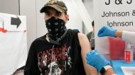 Jay Vojno gets the Johnson & Johnson COVID-19 vaccine, Friday, July 30, 2021 in New York. (AP Photo/Mark Lennihan)