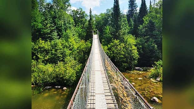 Lovely weekend to enjoy walking the suspension bridge in Pinawa. Photo by Chanelle Lajoie.