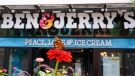 A Monarch butterfly lands on a flower outside the Ben & Jerry's Ice Cream shop in Burlington, Vt., on July 20, 2021. (Charles Krupa / AP)