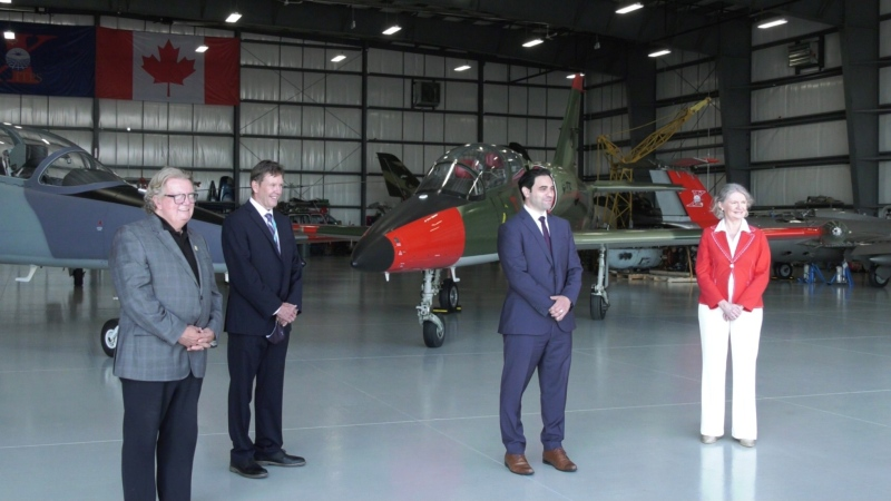 From left, Mayor Ed Holder, London International Airport CEO Mike Seabrook and MPs Peter Fragiskatos and Kate Young at the airport in London, Ont., Tuesday, Aug. 3, 2021. (Jaden Lee-Lincoln / CTV News)