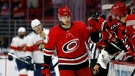 Carolina Hurricanes' Warren Foegele (13) celebrates his goal along the bench during the third period of an NHL hockey game against the Florida Panthers in Raleigh, N.C., Sunday, March 7, 2021. (AP Photo/Karl B DeBlaker)