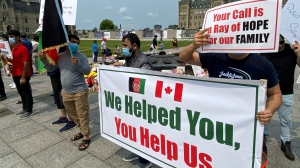 Former Afghan interpreters gather on Parliament Hill on Tuesday, Aug. 3, 2021. Photo by CTV News' Marley Parker