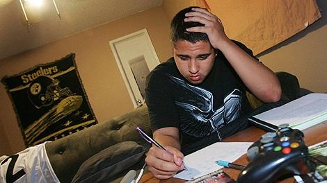 Cameron Hinojosa studies homework and works on resume's at his home Tuesday, Sept. 22, 2009 in Fresno, Calif. (AP Photo/Gary Kazanjian)