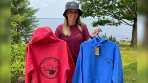 Hannah Summers posing with her merchandise from Summers Signature Designs. (Dylan Dyson / CTV News Ottawa)