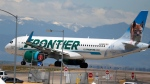 In this June 10, 2020 file photo, a Frontier Airlines jet heads down a runway for take off from Denver International Airport. (AP Photo/David Zalubowski, File)