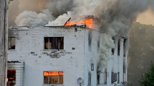 Smoke billows from a fire on Centre Street in London, Ont. on Tuesday, Aug. 3, 2021. (Bryan Bicknell / CTV News)