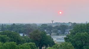 Morning's sun through the smoke in St. Boniface. Photo by Carole Dupuis.