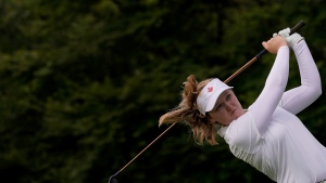 Canada's Brooke Henderson watches her tee shot on the second hole during the first round of the women's golf event at the 2020 Summer Olympics, Aug. 4, 2021, at the Kasumigaseki Country Club in Kawagoe, Japan. (AP Photo/Matt York)