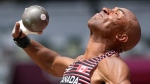 Canada's Damian Warner competes in the shot put of the decathlon at the 2020 Summer Olympics, Aug. 4, 2021, in Tokyo. (AP Photo/David J. Phillip)