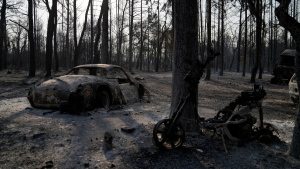 Burned vehicles after a wildfire in Varibobi area, northern Athens, Greece, on Aug. 4, 2021. (Thanassis Stavrakis / AP)
