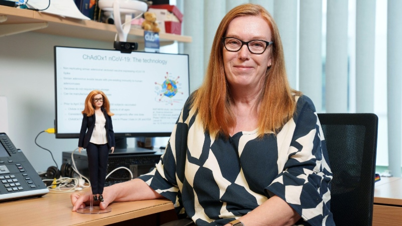 Britain's Professor Sarah Gilbert holds a Barbie doll made in her image. (Andy Paradise / Mattel via AP)