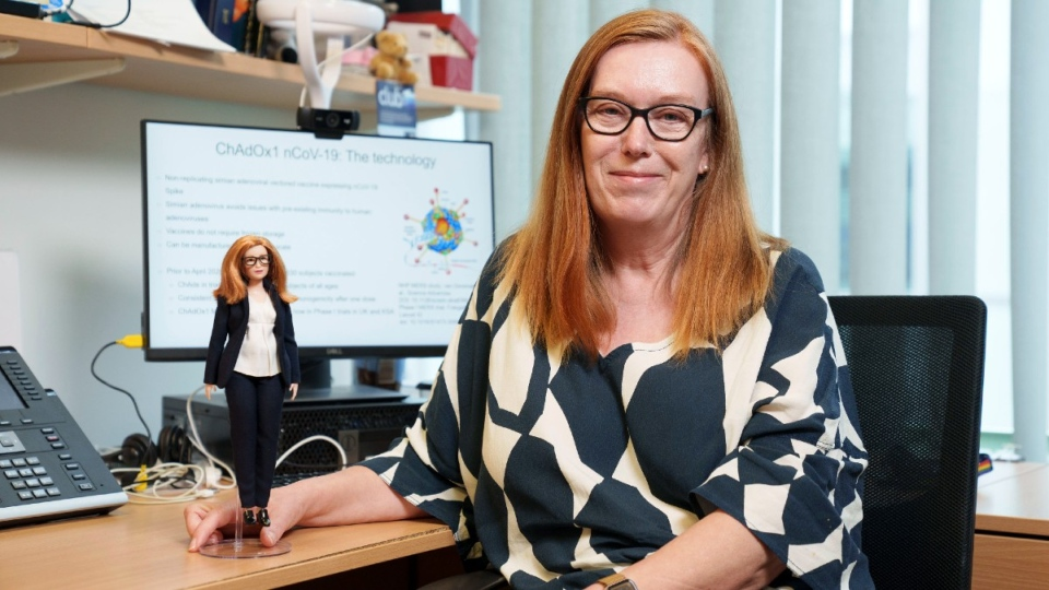 Sarah Gilbert holds a Barbie made in her image