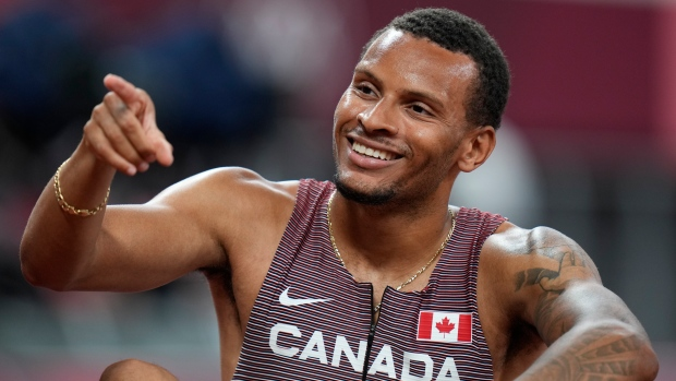 Canada's Andre De Grasse reacts after his semifinal of the men's 200-metres at the 2020 Summer Olympics, Aug. 3, 2021, in Tokyo. (AP Photo/Petr David Josek)