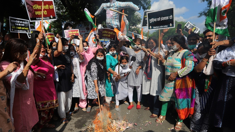 Protesters burn an effigy of Indian Prime Minister Narendra Modi and Delhi Chief Minister Arvind Kejriwal during a demonstration in Delhi on August 3. (Amarjeet Kumar Singh/SOPA Images/Getty Images)