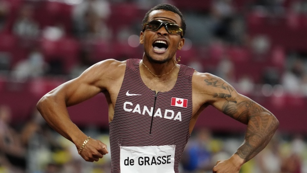 Canada's Andre De Grasse races to a gold medal in the men's 200m final during the Tokyo Olympics in Japan on Wednesday, August 4, 2021. THE CANADIAN PRESS/Frank Gunn