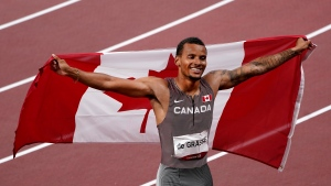 Canada's Andre De Grasse celebrates after his gold medal finish in the men's 200m final event during the Tokyo Summer Olympic Games, in Tokyo, Wednesday, Aug. 4, 2021. THE CANADIAN PRESS/Nathan Denette