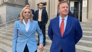 Patricia McCloskey, left, and her husband Mark McCloskey leave a court in St. Louis, on June 17, 2021. (Jim Salter / AP)
