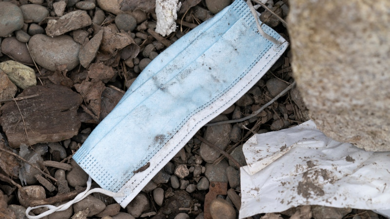 A disposable face mask is pictured on the ground in east Vancouver, Tuesday, March 9, 2021. With more people using disposable gloves and face masks to curb the spread of COVID-19, it has created more litter on city streets. THE CANADIAN PRESS/Jonathan Hayward