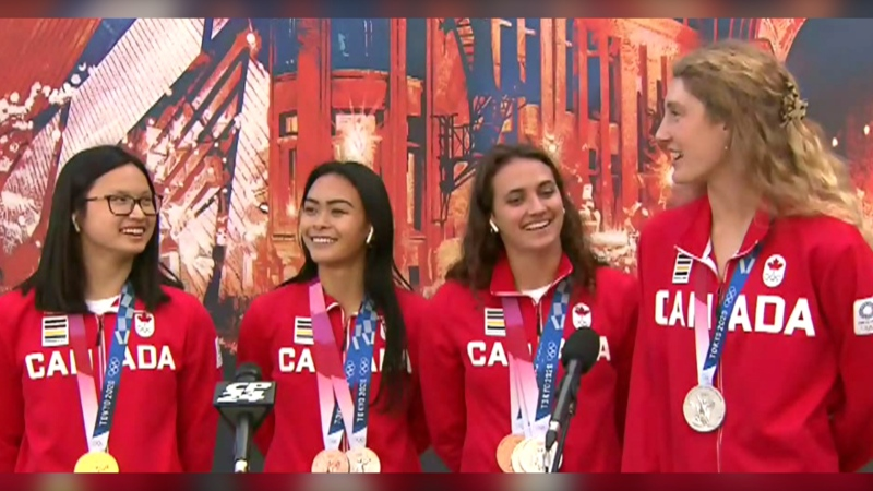 Canadian Olympic swimmers back home