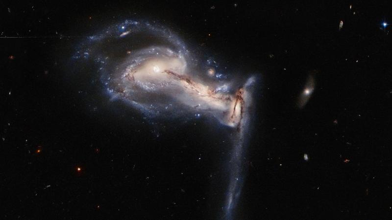 NASA/ESA Hubble Space Telescope captures a three-way gravitational tug-of-war between interacting galaxies. 9ESA/Hubble/NASA/J. Dalcanton/CNN)