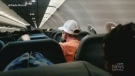Unruly passenger taped to plane seat