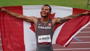 Canada's Andre De Grasse celebrates his gold medal finish in the Men's 200m final during the Tokyo Summer Olympic Games, in Tokyo, Wednesday, Aug. 4, 2021. THE CANADIAN PRESS/Nathan Denette